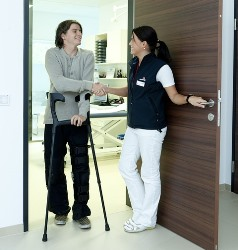 Mobile Alabama LPN greeting man using crutches